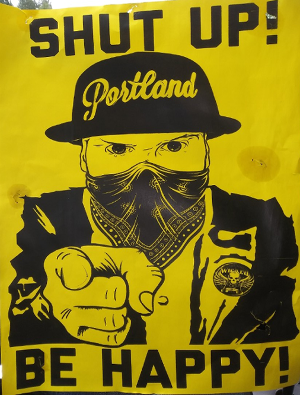 Poster on racism protests & riots snatched from post in Hollywood District, Portland, OR